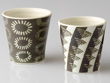 Porcelain beakers, raw glazed with sgraffito and inlay.