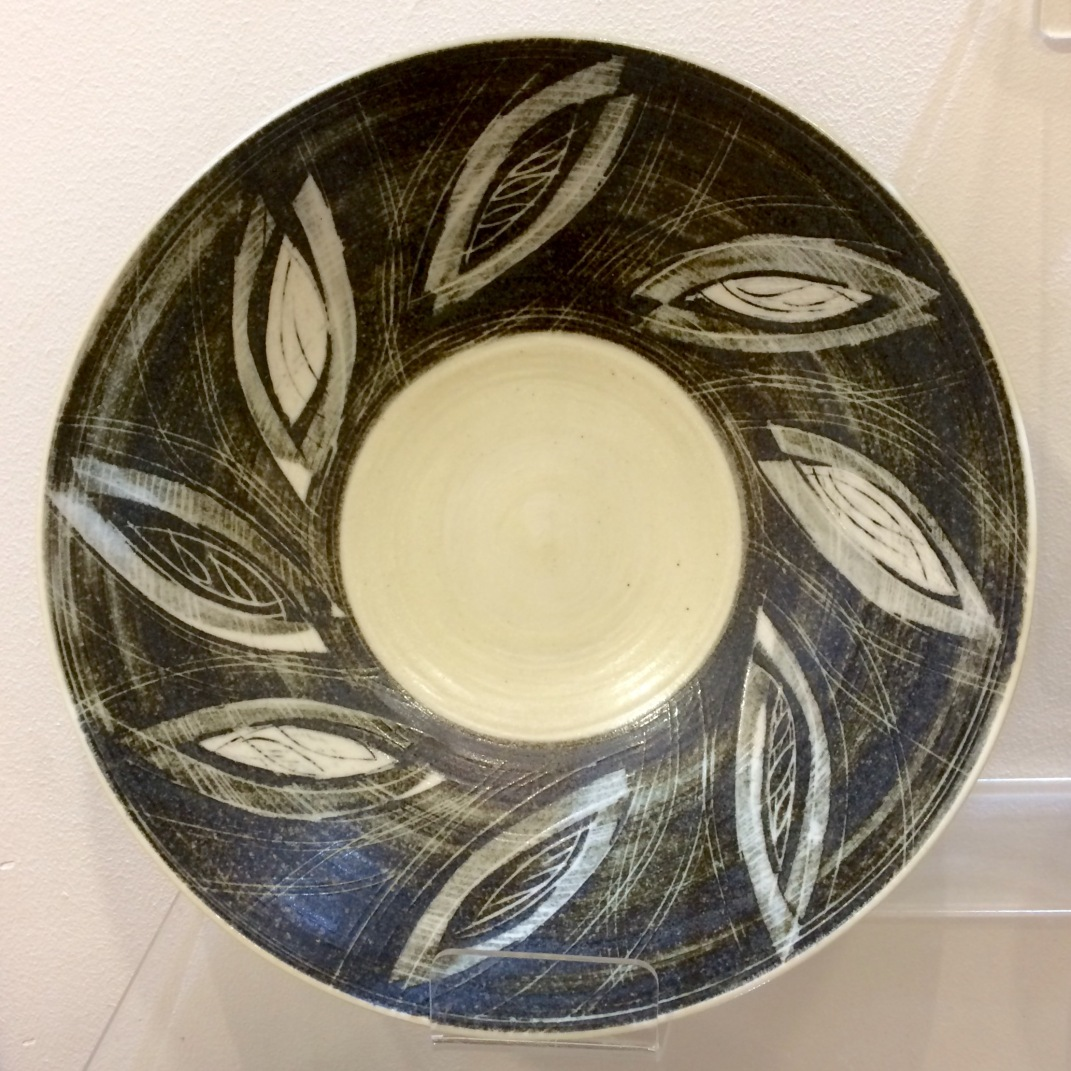 Porcelain bowl,sgraffito, paper resist and inlay.